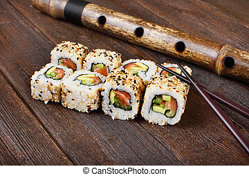 Sushi rolls on a wooden table