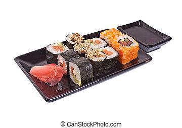 sushi rolls on black plate