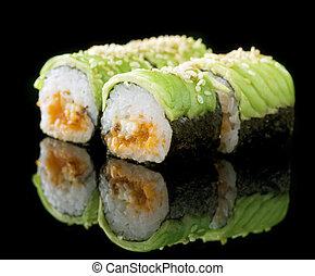 Sushi Rolls Over Black