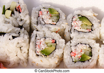 Sushi Rolls - Sushi California Rolls in take-out container.