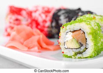 sushi rolls - Sushi rolls made of salmon, avocado, flying ...