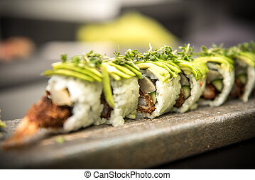 Sushi rolls with prawns on a stone plate