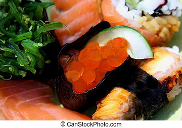 Sushi rolls with red caviar and salmon