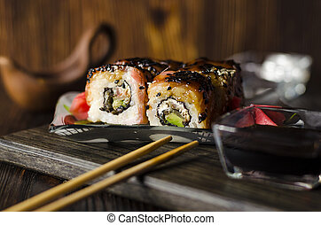 sushi rolls with red fish