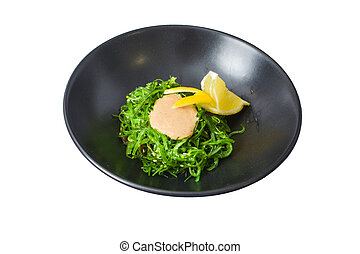 sushi salads in a black plate
