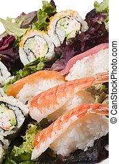 sushi sashimi with california rolls