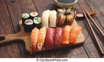 Sushi Set. Different kinds of sushi rolls on wooden serving board