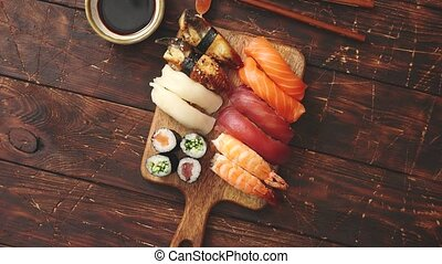 Sushi Set. Different kinds of sushi rolls on wooden serving...