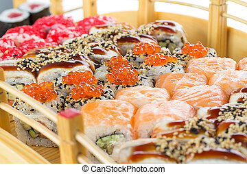 Sushi set on a wooden plate