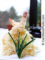 Jumbo shrimp and fresh vegetables lightly battered. Hot and crisp, served with tempura sauce. Shallow DOF.