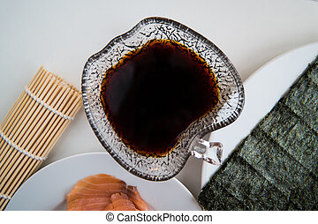 Sushi - Soy sauce in a bowl and ready for sushi - Soy sauce...