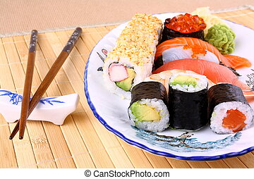 Sushi with red caviar and chopsticks