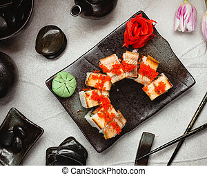 Sushi with red caviar top view