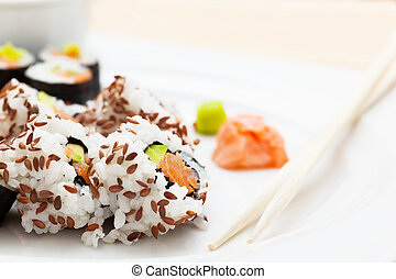 Sushi with salmon, avocado, rice in seaweed served with ...
