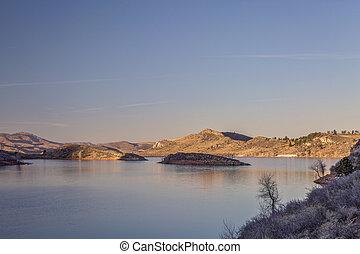 susnset over mountain lake