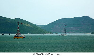 Suspended Cable Cars Cross a Shipping Channel in Nha Trang, Vietnam