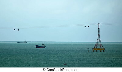 Suspended Trams over a Shipping Channel near Nha Trang, Vietnam
