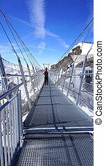 Suspended walkway snow mountains Titlis,  Switzerland