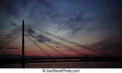 Suspension bridge at night. Riga, Latvia - Suspension bridge...