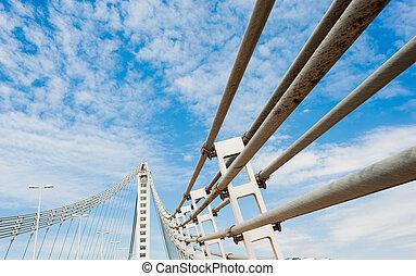 Suspension bridge - Detail take of a modern suspension...