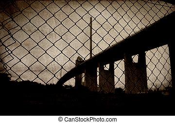 Suspension bridge in sepia grunge image