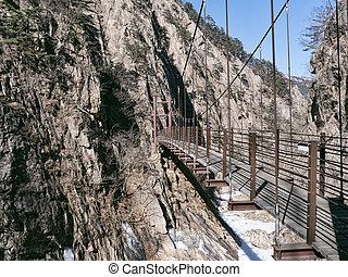 Suspension bridge in the beautiful mountains Seoraksan. Side view