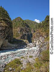 Suspension bridge on the way to Namche Bazar in Himalayas. Everest base camp trek in Nepal. Hillary bridge