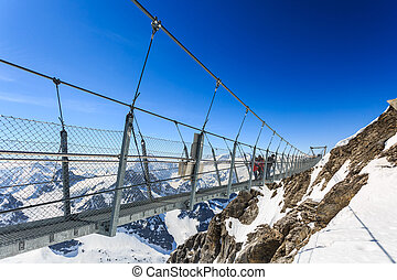 Suspension bridge on Titlis Mountain. - Suspension bridge on...