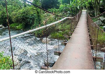 Suspension bridge over Caldera river near Boquete Panama , ...