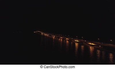suspension cable bridge in surabaya - aerial view lighted...