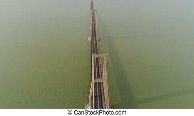 suspension cable bridge in surabaya - aerial view suspension...