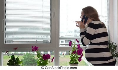 Suspicious pregnant woman calling police on phone while ...
