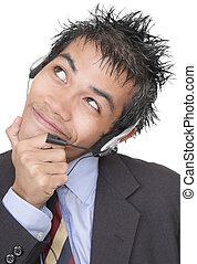 Suspicious smiling telemarketer portrait