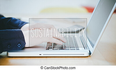 Sustainability, text over young man typing on laptop at desk