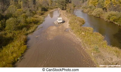 Suv Car Driving on Forest River, Aerial Photography