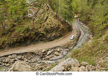 SUV car on a muddy road
