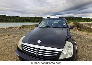 SUV car with gloomy sky