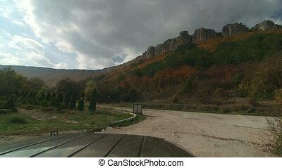 SUV driving in mountainous terrain near Mangup Crimea