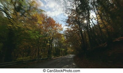 SUV driving on mountain road near Mangup in autumn