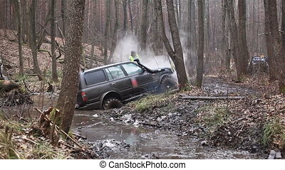 SUV got stuck in the mud in the forest, off-road