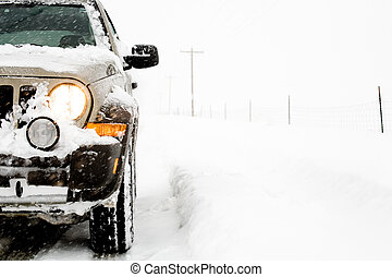 SUV in snow - SUV 4x4 on a snowy day, illuminated headlight,...