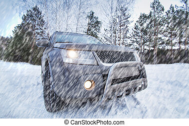 SUV in the forest in winter