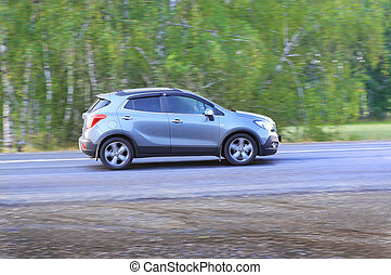 SUV moves on the country road