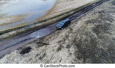 SUV offroad vehicle at filed