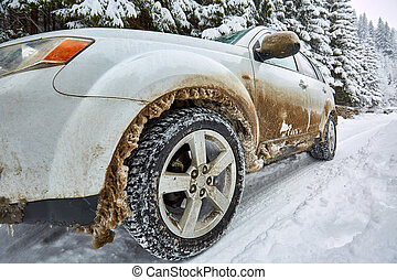 SUV on a mountain road - 4x4 SUV car on a snowy road in the...