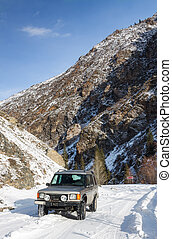 SUV on a snowy mountain road