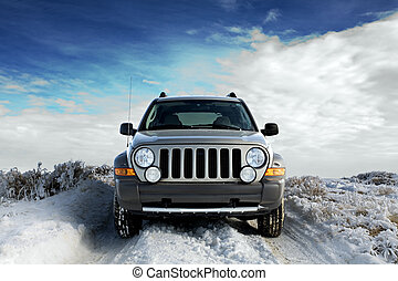 SUV on snow - SUV on a rural snowy frosted road, winter sky...