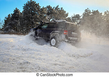 SUV on snow - One SUV cars go on snowy road