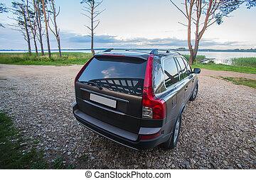 SUV on the lake at sunrise