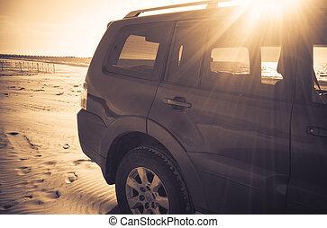 SUV on the sandy beach